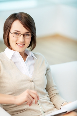 career counseling: Vertical portrait of a successful psychologist or a businesswoman