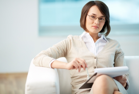 career counseling: Portrait of a friendly counselor being ready to take notes Stock Photo