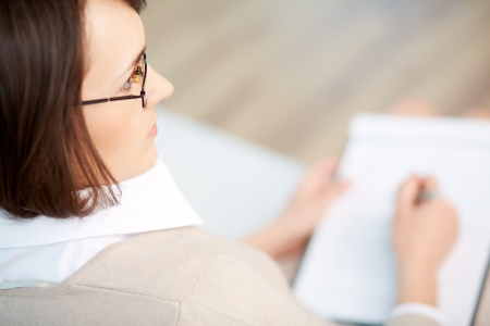 career counseling: Professional psychiatrist keeping record during therapy session