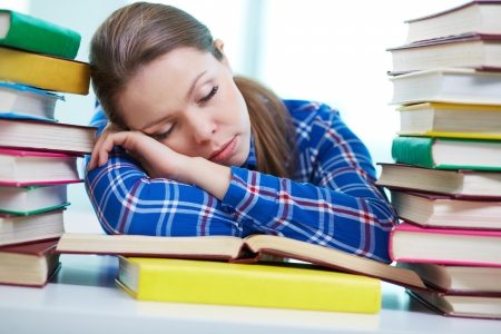 Portrait of cute girl got asleep while reading book Stock Photo - 17883912