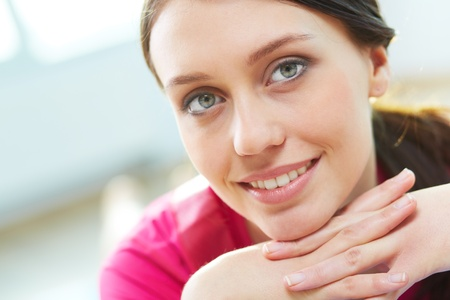 close up face woman: Gorgeous woman looking at camera with smile Stock Photo