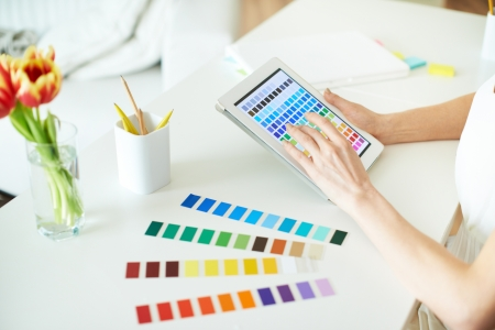 multi touch: Female designer working with colors in touchpad