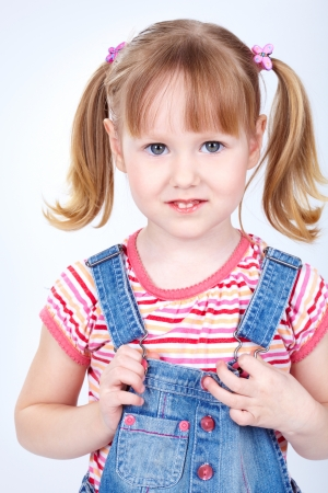 blue eyed: Vertical portrait of a sweet girl in a denim jumpsuit