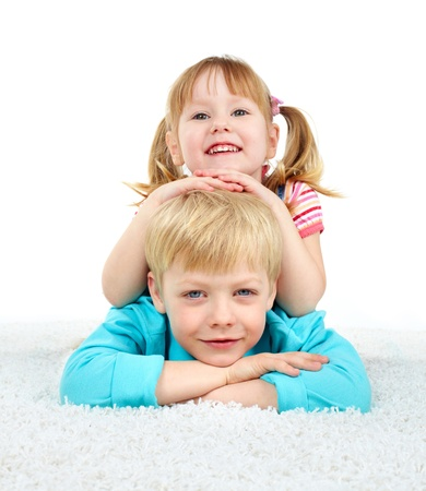 Family portrait, cheerful brother and sister lying on the floor photo