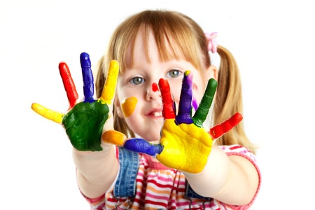 kids painted hands: Girl having fun, her face and palms covered with paint Stock Photo