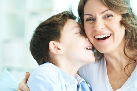 ecstatic: Family of ecstatic mother and son laughing