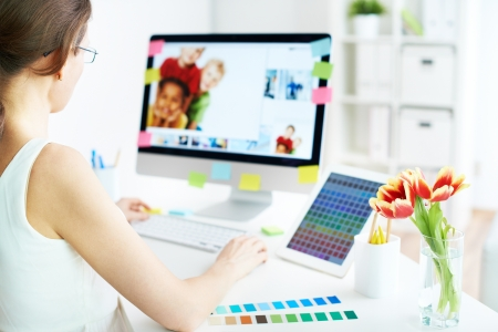 single woman: Female designer working with computer at home