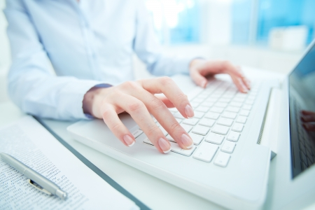 unrecognizable: Hands of white collar worker typing on laptop keypad Stock Photo