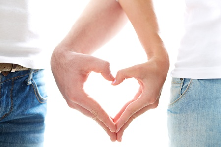 Conceptual image of female and male hands making up heart shape photo