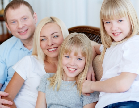 four person: Portrait of happy family with two children smiling at camera  Stock Photo