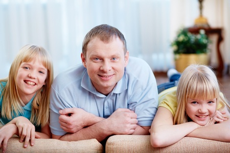 Portrait of happy man with twin daughters looking at camera Stock Photo - 18176763