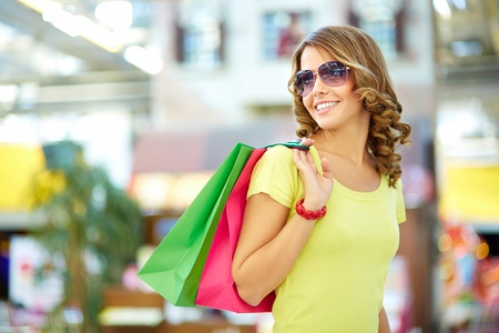 the carefree: Cool shopping girl enjoying a carefree weekend at mall Stock Photo