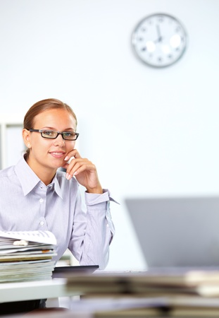 Portrait of smart businesswoman looking at camera in office photo