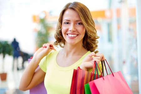 flirty: Portrait of a shopping girl with flirty look