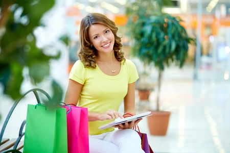 Portrait of a young shopping woman using a touchpad Stock Photo - 18176872