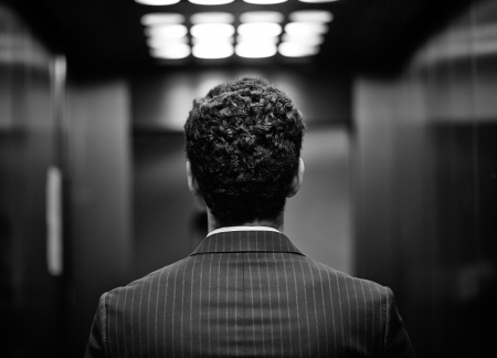back of head: Rear view of young man in suit, black and white image