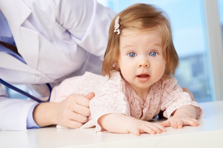 examined: Cute baby being examined in hospital Stock Photo