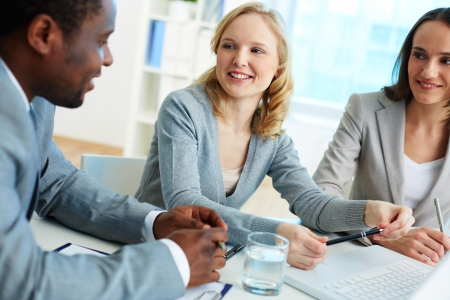 group strategy: Group of friendly businesspeople having meeting