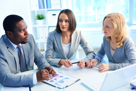 Group of serious businesspeople interacting at meeting Stock Photo - 18327671