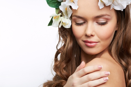 Imagem de uma mulher nua, com flores no cabelo Imagens - 18314779