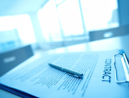 agreeing: Image of business contract and pen on table