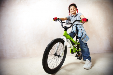 mountainbike: Portrait of happy boy on bicycle looking at camera