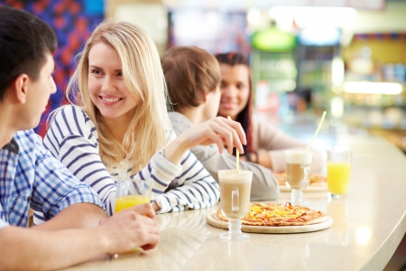woman in cafe: Image of teenage couple interacting in cafe