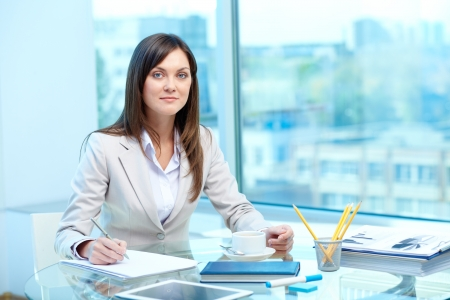proficiency: Portrait of young female writing proficiency test Stock Photo