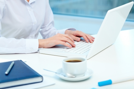 Close-up of female hands typing on laptop Stock Photo - 18591532