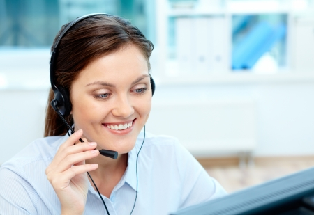 Portrait of young operator with headset consulting clients online Stock Photo - 18591647