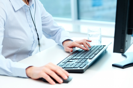 Close-up of female hands during computer work Stock Photo - 18591529