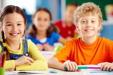 clever: Little students being ready to gain knowledge Stock Photo