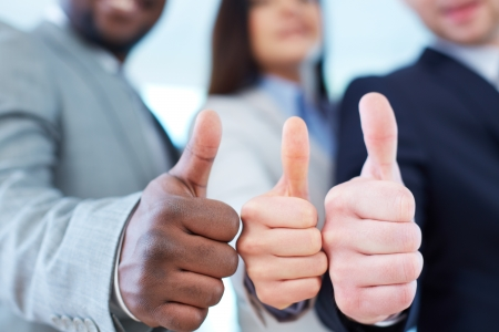 male's thumb: Three business partners keeping thumbs up