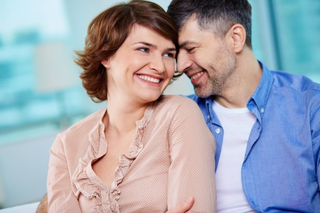 couple laughing: Portrait of happy middle aged couple laughing Stock Photo