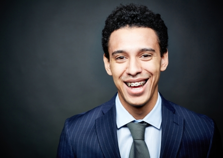 Portrait of a businessman wearing braces and smiling confidently photo