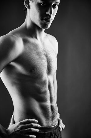 Black-and-white shot of a shirtless guy with muscular body Stock Photo - 18591708