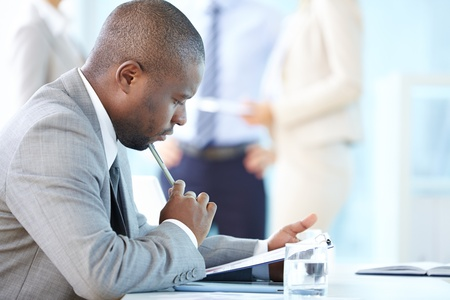 businesspeople: Pensive entrepreneur thinking over financial results