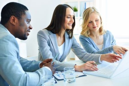 optimal: Team of three considering optimal business solutions Stock Photo