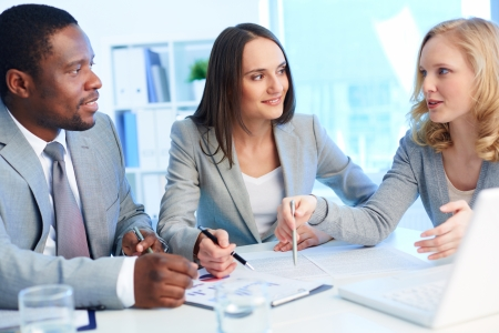 financial team: Office team working with business documents Stock Photo