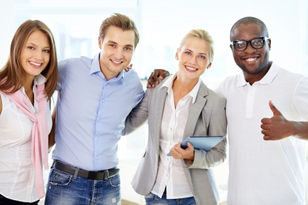 multi racial group: Portrait of successful friends doing business together