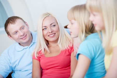 four person: Close-up of a friendly family spending time together
