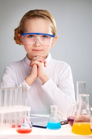 Vertical portrait of an enthusiastic girl loving science photo