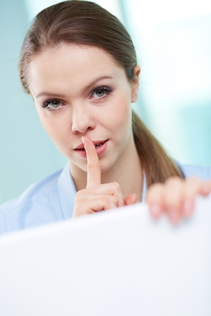 Vertical portrait of a businesswoman stealing corporate secrets Stock Photo - 18729876