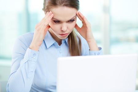 overworking: Overworking businesswoman suffering from headache Stock Photo
