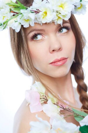 Vertical portrait of a lovely spring girl with dreamy eyes photo