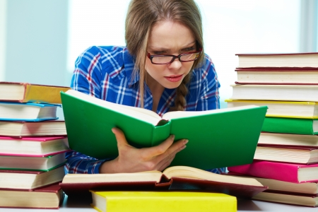 diligent: Diligent student being absorbed in studying Stock Photo
