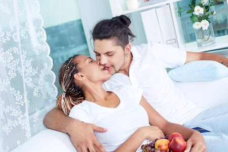 Image of young guy and his girlfriend sharing a grape photo