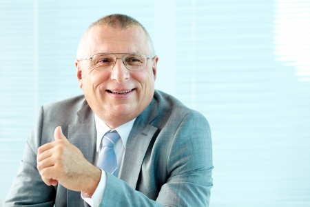 Portrait of elderly businessman in suit and eyeglasses photo