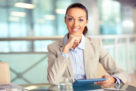 single person: Portrait of confident employee with touchpad looking at camera