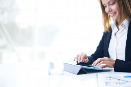 Smart businesswoman working with touchpad photo